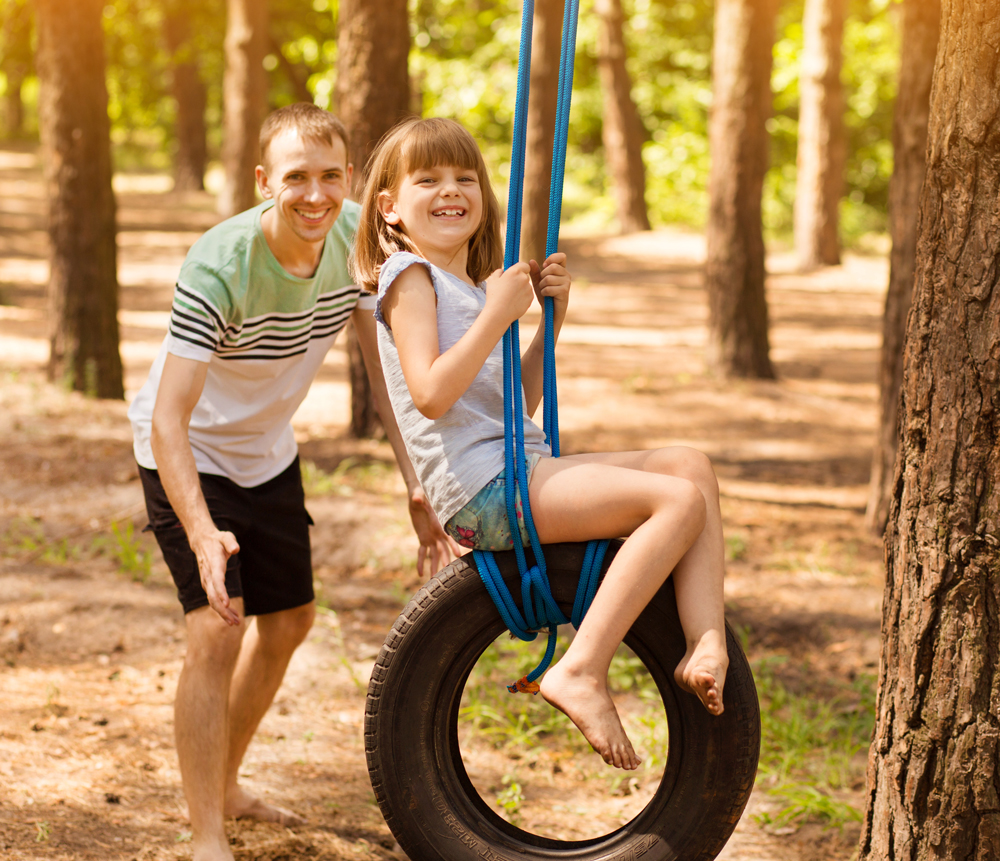 Playing on a tire swing